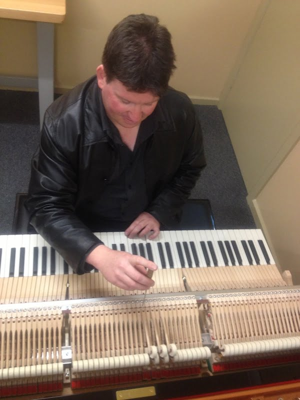 Piano tuner Melbourne doing a major repair and service