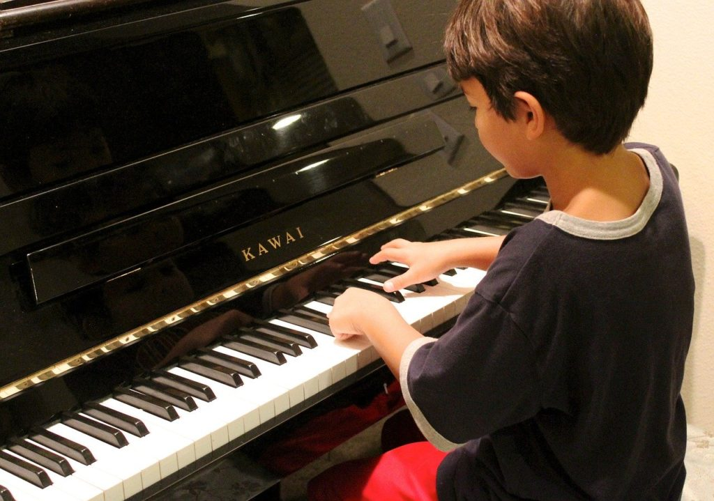 Child learning on piano